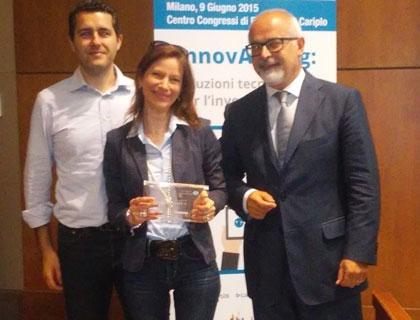 Barbara Gamba e Riccardo Mietti di Badaplus con Mauro Pastori, Direttore Generale di Punto Service